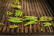Peppers and chilis on a grill