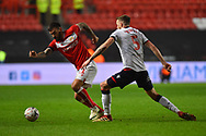 Marlon Pack (21) of Bristol City on the attack gets past Mark Beevers (5) of Bolton Wanderers during the The FA Cup fourth round match between Bristol City and Bolton Wanderers at Ashton Gate, Bristol, England on 25 January 2019.