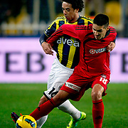 Fenerbahce's Cristian Oliveira Baroni (L) and Gaziantepspor's Ismael Sosa (R) during their Turkish superleague soccer match Fenerbahce between Gaziantepspor at the Sukru Saracaoglu stadium in Istanbul Turkey on Monday09 January 2011. Photo by TURKPIX