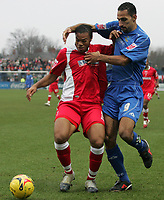 Photo: Paul Thomas.<br /> Macclesfield Town v Swindon Town. Coca Cola League 2. 23/12/2006.<br /> <br /> Jerel Ifil (L) of swindon tries to hold off Matty McNeil.