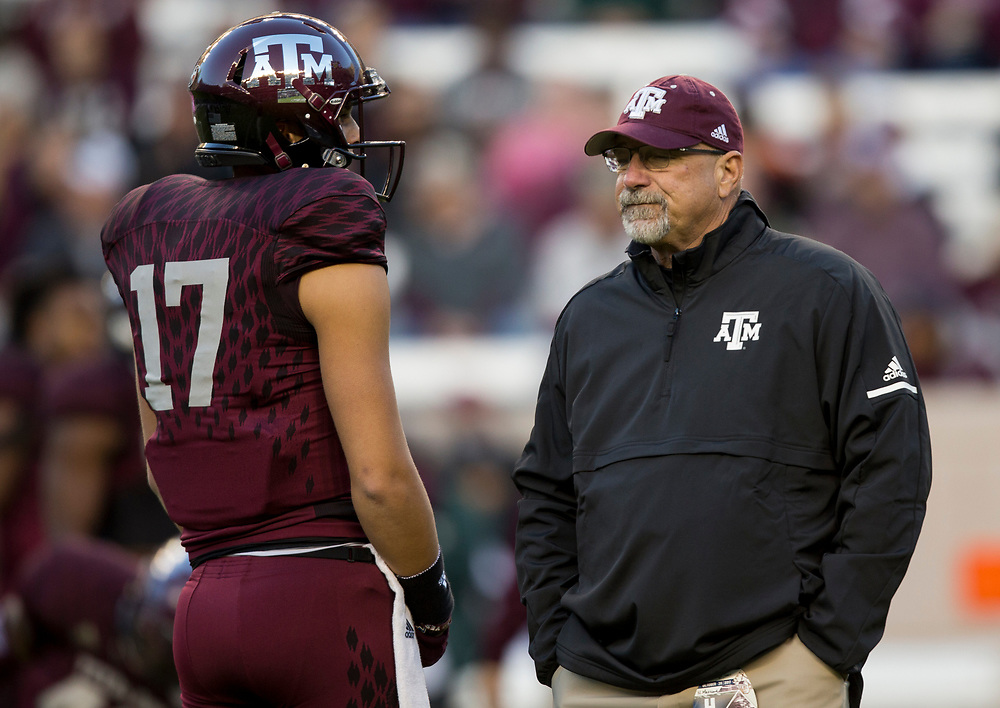 Texas A&M offensive coordinator Noel Mazzone watches warmups before the start of a NCAA college game against Mississippi State on Saturday, Oct. 28, 2017, in College Station, Texas. (AP Photo/Sam Craft)