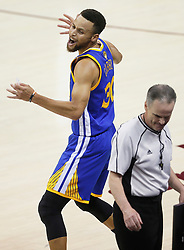 The Golden State Warriors' Stephen Curry reacts to a foul called against him during action against the Cleveland Cavaliers in the first quarter during Game 4 of the NBA Finals at Quicken Loans Arena in Cleveland on Friday, June 9, 2017. (Photo by Leah Klafczynski/Akron Beacon Journal/TNS) *** Please Use Credit from Credit Field ***