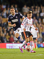 Fulham's Patrick Roberts in action during the match against Bolton Wanderers<br /> <br /> Photographer Ashley Western/CameraSport<br /> <br /> Football - The Football League Sky Bet Championship - Fulham v Bolton Wanderers - Wednesday 01st October 2014 - Craven Cottage - London<br /> <br /> © CameraSport - 43 Linden Ave. Countesthorpe. Leicester. England. LE8 5PG - Tel: +44 (0) 116 277 4147 - admin@camerasport.com - www.camerasport.com