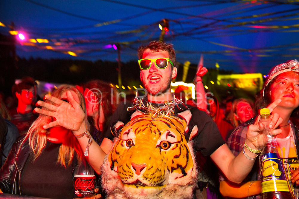 Glastonbury Festival, 2015. Shangri La is a festival of contemporary performing arts held each year within Glastonbury Festival. The theme for the 2015 Shangri La was Protest. Dancing in front of the Hell stage on the last night.