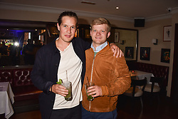 Left to right, Earl of March and Kinrara and Lord Porchester at The Tribe Syndicate launch party hosted by Highclere Thoroughbred Racing at Beaufort House, 354 King's Rd, London England. 25 April 2018.