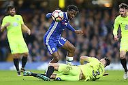Andrew Hughes of Peterborough United attempting to block Michy Batshuayi of Chelsea. The Emirates FA cup, 3rd round match, Chelsea v Peterborough Utd at Stamford Bridge in London on Sunday 8th January 2017.<br /> pic by John Patrick Fletcher, Andrew Orchard sports photography.