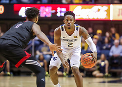 Dec 14, 2019; Morgantown, WV, USA; West Virginia Mountaineers guard Brandon Knapper (2) dribbles while defended by Nicholls State Colonels guard Jeremiah Buford (11) during the second half at WVU Coliseum. Mandatory Credit: Ben Queen-USA TODAY Sports