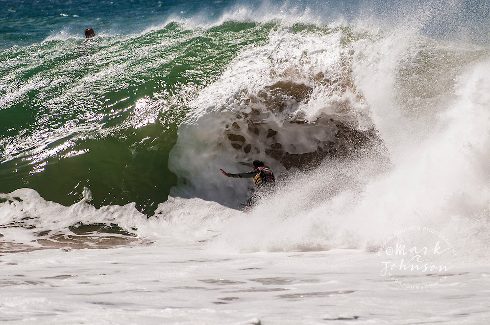 Surfer riding a powerful wave in Hawaii