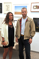 LULU KENNEDY and WOLFGANG TILLMANS at a private view of work by artist Elizabeth Peyton 'Live Forever' held at the Whitechapel Gallery, 77-82 Whitechapel High Street, London E1 on 7th July 2009.