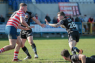 Jordan Lilley (Bradford Bulls) goes to hand off Nathan Mason (Oldham Roughyeds) as he collects the ball and runs for the try line during the Kingstone Press Championship match between Oldham Roughyeds and Bradford Bulls at Bower Fold, Oldham, United Kingdom on 2 April 2017. Photo by Mark P Doherty.