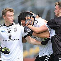 Ennistymon's Cathal Malone is pushed by Doonbeg's Michael Tubridy off the ball