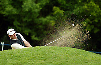 Photograph: Scott Heavey<br />Volvo PGA Championship At Wentworth Club. 25/05/2003.<br />Paul Casey chips from the bunker at the 4th.
