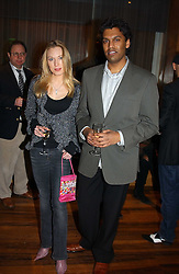 The HON.IMOGEN LLOYD WEBBER daughter of Andrew Lloyd Webber and MR DARRYL SAMARAWEERA at the opening party of Pengelley's, 164 Sloane Street, London SW1 on 22nd February 2005.<br /><br />NON EXCLUSIVE - WORLD RIGHTS
