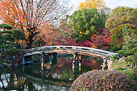 """A wooden bridge called Shinsetsu-kyo connects the west edge of Ingetsu-chi pond and Kita-oshima, the north island. Shosei-en Garden was designed as a retreat for the chief priest Sen'nyo.  Shosei-en is also called Kikoku-tei """"Orange Mansion"""" because it was once surrounded by orange groves. The garden is a Chisen-Kaiyu-Shiki teien  that is a pond strolling garden with buildings such as tea-ceremony houses arranged here and there throughout the grounds."""