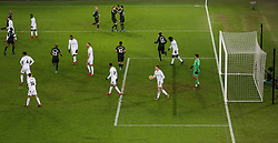 Swansea City's Alfie Mawson collects the ball as Manchester City celebrate the second goal