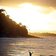A surfer rides at Tea Tree Bay at Noosa Heads, Australia.