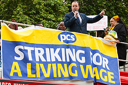 London, UK. 19 June, 2019. Chris Stephens, Scottish National Party (SNP) MP for Glasgow South West, addresses outsourced catering, security, postal, porter and cleaning staff belonging to the Public & Commercial Services Union (PCS) and working at the Department for Business, Energy and Industrial Strategy (BEIS) via contractors ISS World and Aramark at a rally outside Parliament on the third day of continuing industrial action for the London Living Wage, terms and conditions comparable to the civil servants they work alongside and an end to outsourcing.
