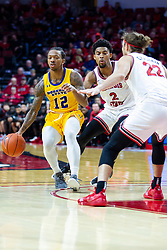 NORMAL, IL - December 07: Zach Copeland forces the direction of Justin Thomas by pushing him towards Matt Chastain during a college basketball game between the ISU Redbirds and the Morehead State Eagles on December 07 2019 at Redbird Arena in Normal, IL. (Photo by Alan Look)