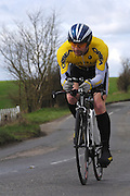 United Kingdom, Finchingfield, Mar 27, 2010:  Ben Caisey, Stowmarket & Dist CC - Porche/Orbea, approaches the 4 miles to go marker during the 2010 edition of the 'Jim Perrin' Memorial Hardriders 25.5 mile Sporting TT promoted by Chelmer Cycling Club. Copyright 2010 Peter Horrell.
