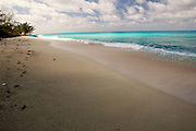 Empty beach along the Queen's Highway in Alice Town on the tiny Caribbean island of Bimini, Bahamas.