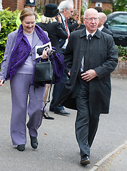 © licensed to London News Pictures. 18/05/2011. Tonbridge, UK. Sir Bobby Charlton and his Wife Norma at the funeral of heavyweight boxing legend Sir Henry Cooper at Corpus Christi Church in Lyons Crescent, Tonbridge, Kent today (18/05/2011).  Please see special instructions for usage rates. Photo credit should read Ben Cawthra/LNP