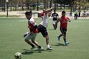 People play soccer at at MacArthur Park amid the global coronavirus COVID-19 pandemic, Sunday, May 10, 2020, in Los Angeles.