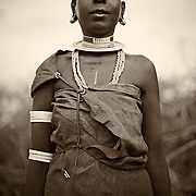 """""""Dtoga Matriarch""""                                 Tanzania<br /> We visited the Dtoga tribe in Tanzania and were quickly welcomed by the matriarch of the tribe.   Her strength and beauty were captivating,  yet  somehow haunting .  <br />  I was struck by the tribe's strong sense of community and pride."""