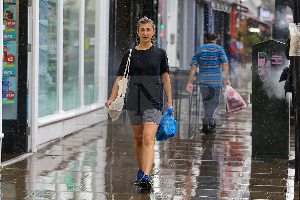 © Licensed to London News Pictures. 10/09/2021. London, UK. A woman is caught during rainfall in north London, as wet weather conditions continue after a recent mini heatwave in London. Photo credit: Dinendra Haria/LNP