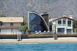EXCLUSIVE: Edward Norton drops $11.8 Million on unusual Malibu Colony house. Edward Norton bought the house from architecture collector and movie producer Michael LaFetra. The five-bedroom, five-bathroom house on the beach in the exclusive and gated Malibu Colony. 15 Aug 2017 Pictured: Edward Norton Malibu House. Photo credit: MEGA TheMegaAgency.com +1 888 505 6342