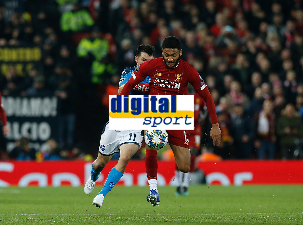 Football - 2019 / 2020 UEFA Champions League - Group E: Liverpool vs. Napoli<br /> <br /> Joe Gomez of Liverpool cases the ball with Hirving Lozano of SSC Napoli  in pursuit, at Anfield.<br /> <br /> COLORSPORT/ALAN MARTIN