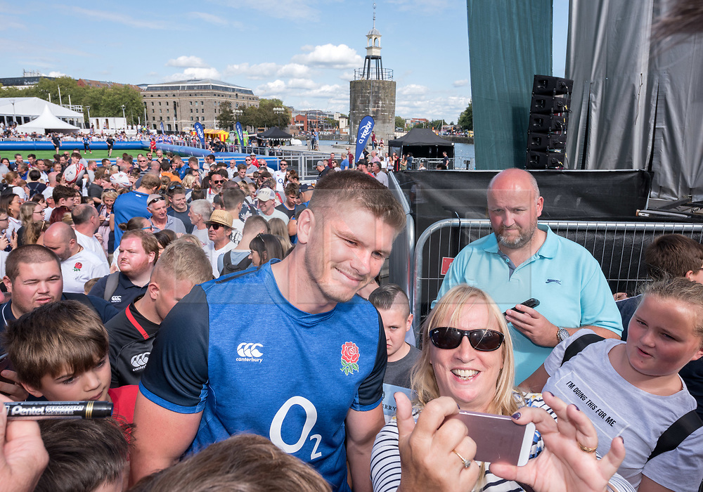 © Licensed to London News Pictures. 13/08/2019; Bristol, UK. OWEN FARRELL, Captain of the England Rugby team meet fans after being introduced by host Vernon Kay at the Wear the Rose Live event at the Lloyds Amphitheatre on Bristol Harbourside. England's 31-man squad for the Rugby World Cup in Japan are attending the event in Bristol on Tuesday. The free-of-charge Wear the Rose Live from England sponsor O2 will see the full squad and coaches and special guest Jonny Wilkinson spend an afternoon in Lloyds Amphitheatre. The event features live music alongside a variety of carnival stalls and rugby games, manned by the players, with a chance for fans to win prizes. Photo credit: Simon Chapman/LNP.