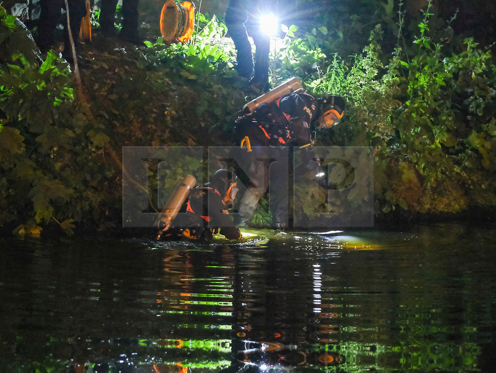 © Licensed to London News Pictures. 16/07/2019. Manchester, UK. A specialist police diving unit searches the River Irwell in Manchester city centre where the body has been found after reports that a man had fallen in. Photo credit: Stephen Cottrill/LNP
