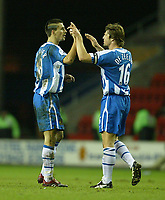 Photo: Aidan Ellis.<br /> Wigan Athletic v Arsenal. Carling Cup. Semi Final, 1st Leg.<br /> 10/01/2006.<br /> Wigan's goal scorer  Paul Scharner is congratulated on scoring on his debut by team mate Arjun De Zeeuw.