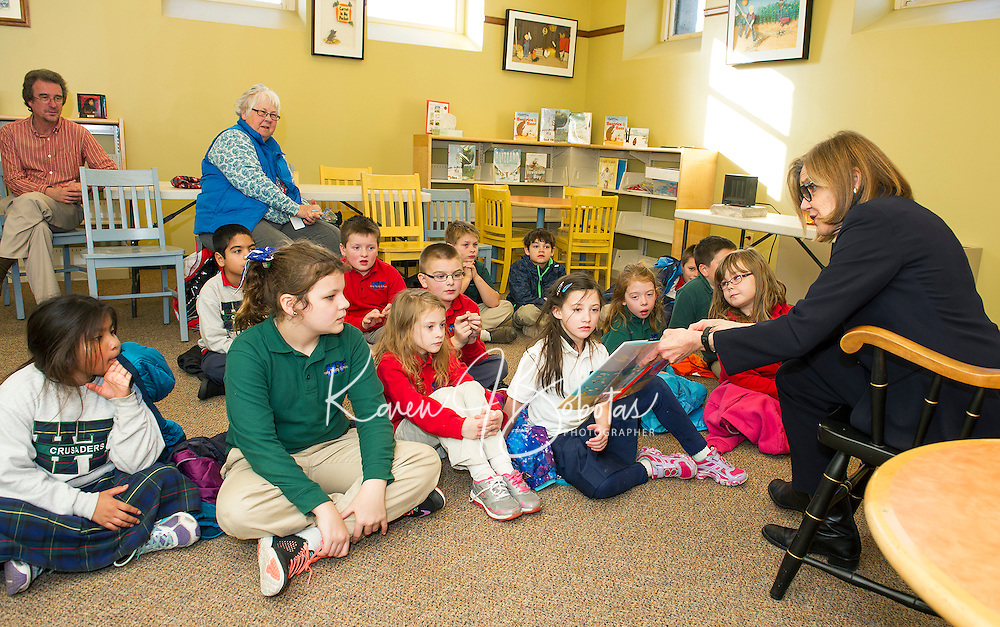 """Author Elizabeth Howard reads """"A Day with Bonefish Joe""""  to Mrs. Gressner's 2nd and 3rd grade students from Holy Trinity School at the Laconia Library on Tuesday afternoon.  (Karen Bobotas/for the Laconia Daily Sun)"""
