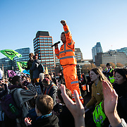 Thousands of Extinction Rebellion activists took over 5 bridges in Central London and blocked them for the day, November 17 2018, Central London, United Kingdom. Lambeth Bridge; a speaker from Lancashire and the anti-fracking movement adresses the crowd sitting in the road.  Around 11am people on all bridges sat down in the road and blocked traffic from coming through and stayed till late afternoon. The actvists believe that the government is not doing enough to avoid catastrophic climate change and they demand the government take radical action to save future generations and the planet. Many are willing to be arrested peacefully protesting and up to 80 were arrested on the day. Extinction Rebellion is a grass root climate change group started in 2018 and has gained a huge following of people commited to peaceful protests and who ready to be arrested. Their major concern is that the world is facing catastropohic climate change and they want the British government to act now to save future generations.