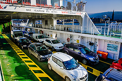 Vehicles aboard the Calmac ferry 'Loch Shira' en route from Largs on the Scottish mainland to the island of Great Cumbrae<br /> <br /> (c) Andrew Wilson   Edinburgh Elite media