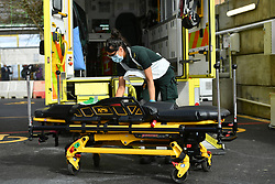 A paramedic cleans down equipment in the ambulance decontamination area outside the Respiratory Assessment Unit, which receives coronavirus patients, at the Morriston Hospital in Swansea, as the health services prepare their response to the coronavirus outbreak.