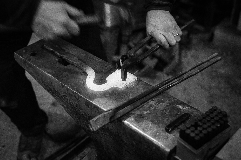 Stamping the owner's initials into the steel.