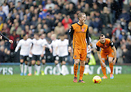 George Saville of Wolves reacts following Derby's third goal - Football - Sky Bet Championship - Derby County vs Wolverhampton Wanderers - iPro Stadium Derby - Season 2014/15 - 8th November 2014 - Photo Malcolm Couzens/Sportimage