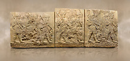 Photo of Hittite sculpted orthostats panels of Long Wall Limestone, Karkamıs, (Kargamıs), Carchemish (Karkemish), 900-700 B.C. Soldiers. Anatolian Civilisations Museum, Ankara, Turkey<br /> <br /> Figures of helmeted warriors. They have their shield in their back and their spear in their hand. The prisoner in their front is depicted as small. The lower part of the orthostat is decorated with braiding motifs. <br /> <br /> On a brown art background. .<br /> <br /> If you prefer to buy from our ALAMY STOCK LIBRARY page at https://www.alamy.com/portfolio/paul-williams-funkystock/hittite-art-antiquities.html  - Type  Karkamıs in LOWER SEARCH WITHIN GALLERY box. Refine search by adding background colour, place, museum etc.<br /> <br /> Visit our HITTITE PHOTO COLLECTIONS for more photos to download or buy as wall art prints https://funkystock.photoshelter.com/gallery-collection/The-Hittites-Art-Artefacts-Antiquities-Historic-Sites-Pictures-Images-of/C0000NUBSMhSc3Oo