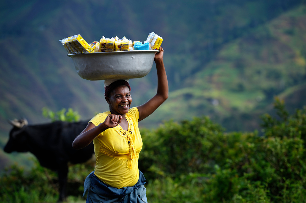 A woman walks along a road carrying goods to market in Les Palmes, a rural village in southern Haiti where the Lutheran World Federation has been working with survivors of the 2010 earthquake, along with other residents, to experience more abundant life.