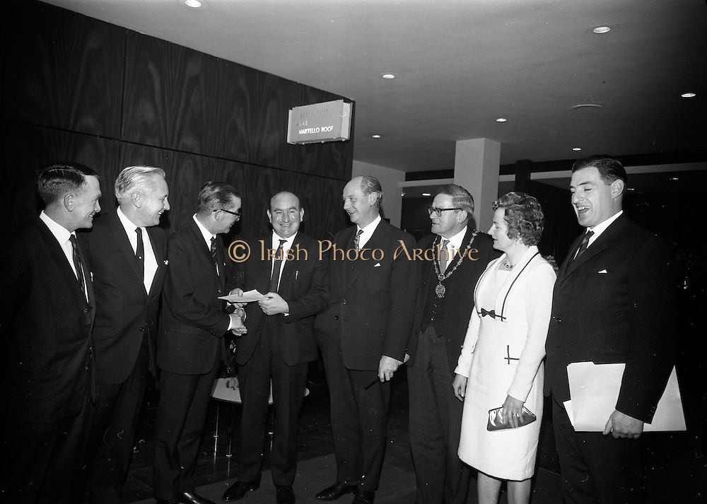 16/11/1966<br /> 11/16/1966<br /> 16 November 1966<br /> O'Brien Plastics Ltd., Bishopstown, Cork reception at the Intercontinental Hotel, Dublin to announce that Phillips Petroleum Company, Oklahoma U.S.A had acquired a 50% interest in O'Brien Plastics. Picture Shows cheque for £500 presented by Mr. Willie O'Brien, O'Brien Plastics Ltd., to Lord Mayor of Cork Sean Casey T.D. to send Mr. Patrick McCarty to the United States on a development tour. Pictured (l-r): Mr. Patrick J. McCarty, development Manager, Cork Economic Development Council; Mr. Edwin Van der Bark, Phillips Petroleum Co.; Alderman Sean Casey; Mr. William O'Brien; Taoiseach Jack Lynch; Eugene Timmons, Lord Mayor of Dublin; Mrs. O'Brien and Mr. Gerald Horgan, Secretary, O'Brien Plastics Ltd.