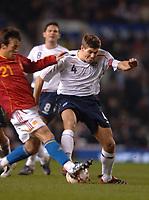 Photo: Paul Greenwood.<br />England v Spain. International Friendly. 07/02/2007. Spains David Silva, left, launches a crunching tackle on Englands Steven Gerrard