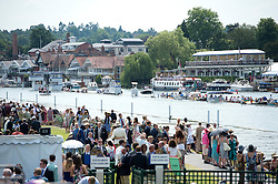 © London News Pictures. 05/07/2012.  Henley-on-Thames, UK. Spectators enjoy the warm weather  on day three of Henley Royal Regatta on the River Thames at Henley-on-Thames, Oxfordshire on July 03, 2013. The 5 day regatta over the first weekend in July, races head-to-head knock out competitions over a course of 1 mile between rowing teams from throughout the world. Photo credit: Ben Cawthra/LNP