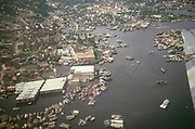 Oblique aerial view of Rio Negro river and city of Manaus, Brazil 1962, the foreground shows informal wooden housing of the Floating City