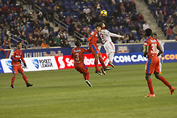 March 1, 2018 - Harrison, New Jersey, United States - German Mejia (29) of CD Olimpia of Honduras & Alex Muyl (19) of New York Red Bulls fights for ball during 2018 CONCACAF Champions League round of 16 game at Red Bull arena, Red Bulls won 2 - 0  (Credit Image: © Lev Radin/Pacific Press via ZUMA Wire)