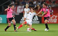 Football - 2017 UEFA Women's European [Euro] Championship - Group D: England vs. Scotland<br /> <br /> Caroline Weir and Rachel Crosby of Scotland hold back Jill Scott of England at Stadion Gagenwaard, Utrecht.<br /> <br /> COLORSPORT/LYNNE CAMERON