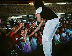 A local pop star performs for the families of  Overseas Filipino Workers, OFWs at the Enchanted Kingdom in Santa Rosa, Laguna, Philippines on Dec. 2006. This is one of many holiday events organized by the Overseas Workers Welfare Administration, OWWA, held throughout the Philippines to welcome the roughly 120,000 OFWs that came home for the Christmas season.