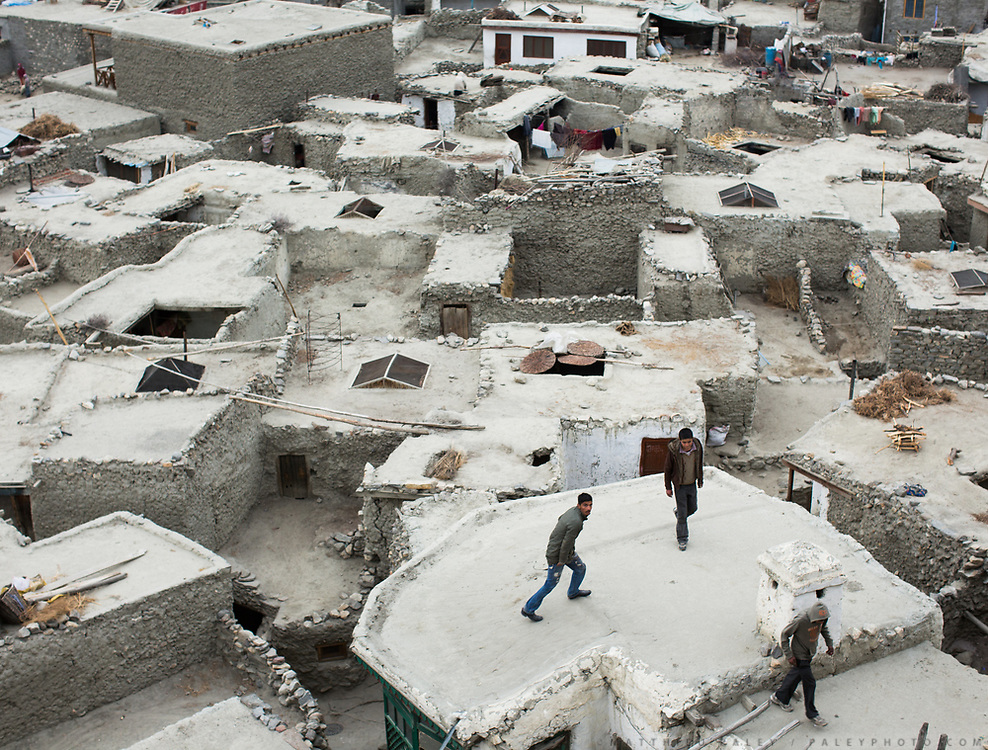 Teenager play on the roofs, in the old fortified village of Altit, over 1000 years old, Hunza region.