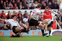 Fredrik Ljungberg (Arsenal) Stanislav Varga & Jody Creddock (Sunderland). Arsenal 2:2 Sunderland. FA Carling Premiership, 30/12/2000. Credit Colorsport / Stuart MacFarlane.